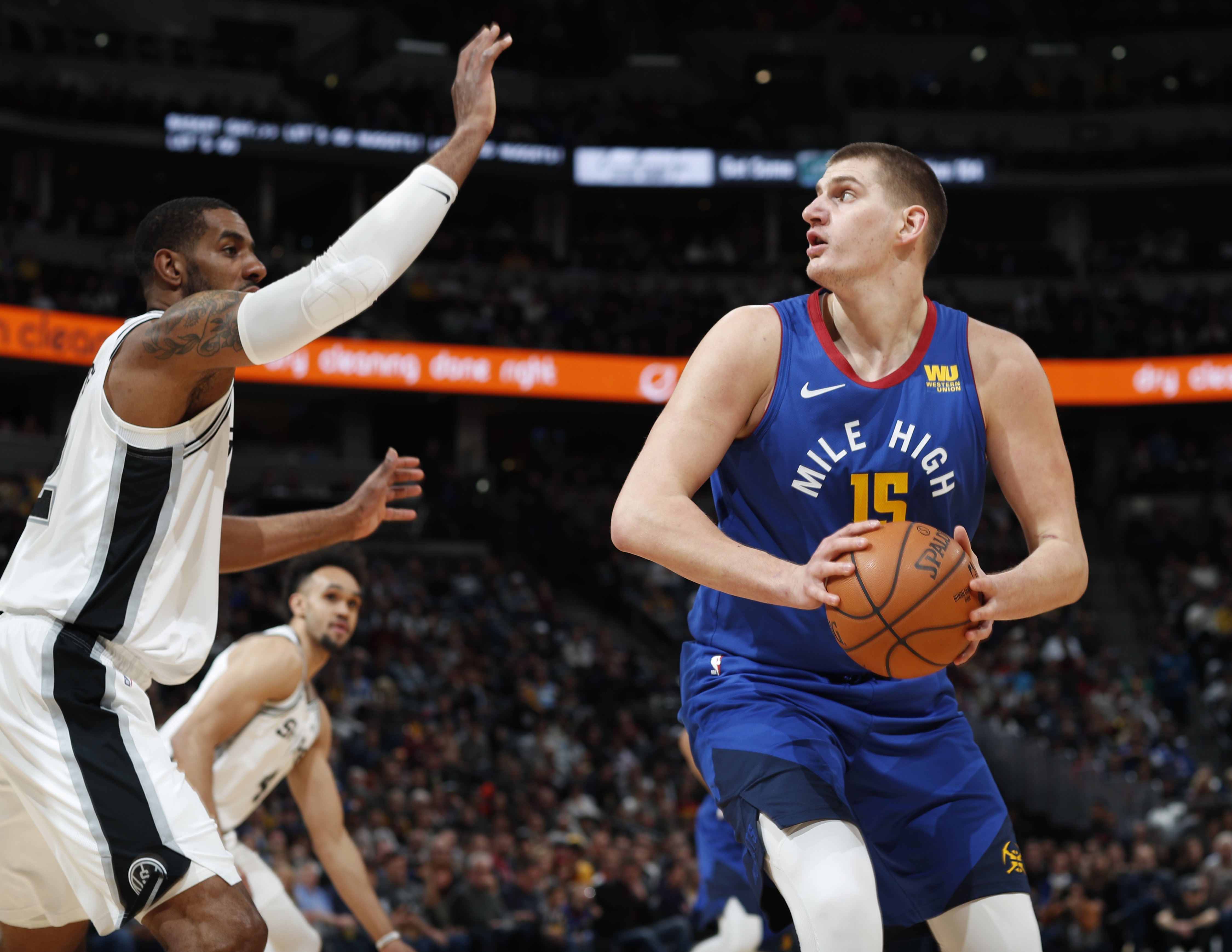 detailing 22505 39d98 Nuggets keep rolling at home, hold off Spurs 102-99 ...
