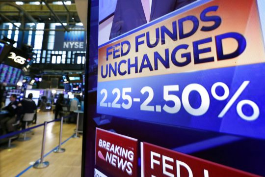 US Federal Reserve holds rates steady, cuts economic growth forecast