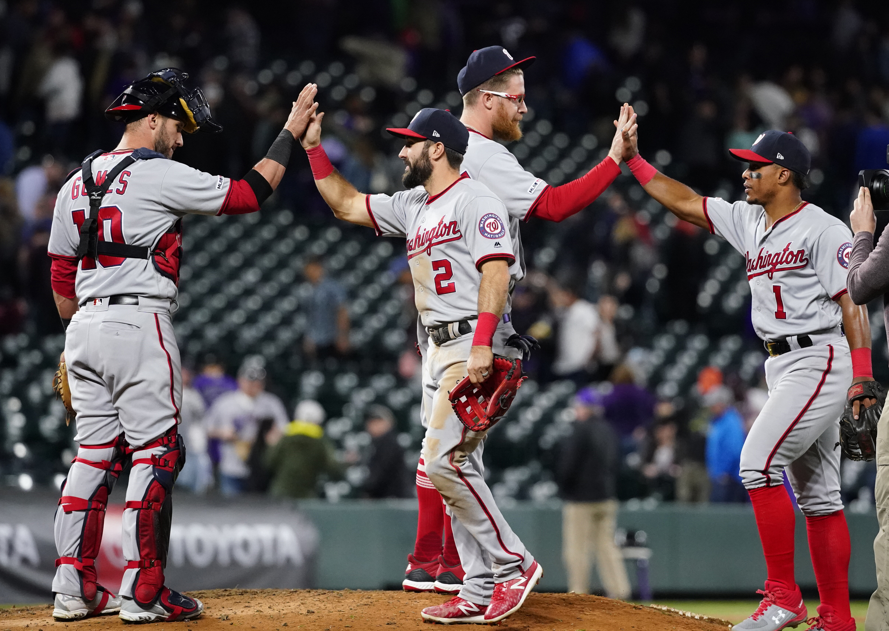 save off e9053 88383 Washington Nationals right fielder Adam Eaton (2) and Wilmer Difo celebrate  a 6-3 win against the Colorado Rockies with teammates Yan Gomes (10) and  Sean .