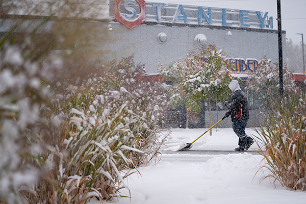 The first metro snow of the season got everyone out with shovels, scrapers, umbrellas and coats. Forecasters were predicting up to 5 inches of snow in Aurora before the storm moves out later Thursday. PHOTO BY PHILIP B. POSTON. Sentinel Colorado