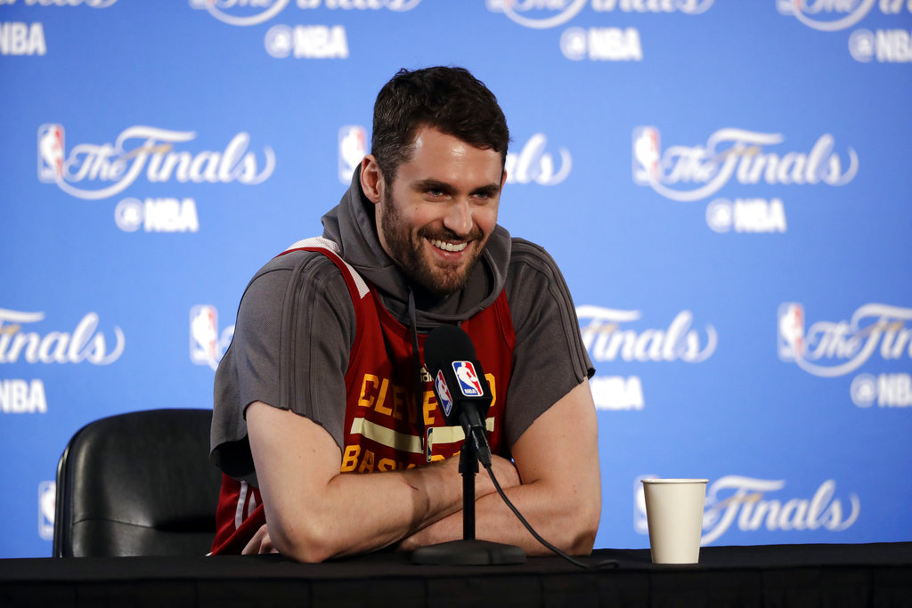 afb42f6fea07 Cleveland Cavaliers  Kevin Love smiles as he fields questions before an NBA  basketball practice