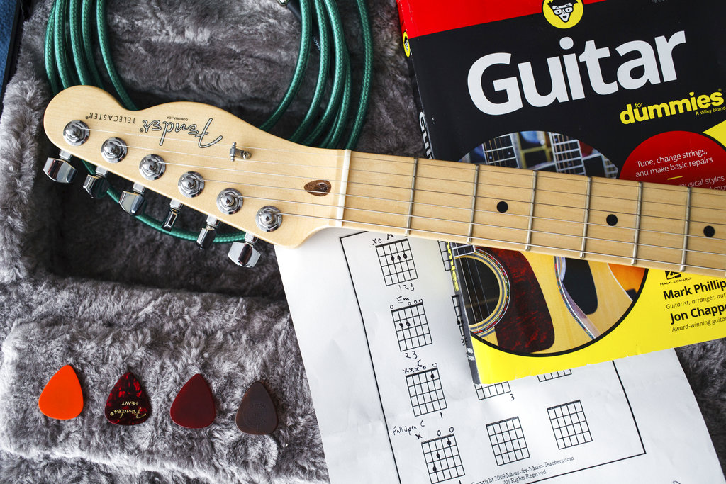 Learning to play guitar at age 50 - Sentinel Colorado