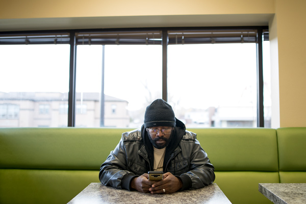 Joshua Fobbs, A Graduate Of The Ready To Work Program At The Bridge House  In Boulder, Plays Scrabble On His Phone In The Cafeteria Of The Bridge House  ...