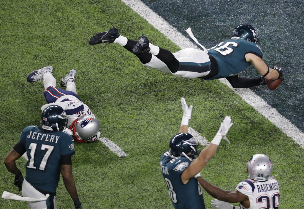 Philadelphia Eagles tight end Zach Ertz scores past New England Patriots  free safety Devin McCourty during the second half of the NFL Super Bowl 52  football ... df7da29eb